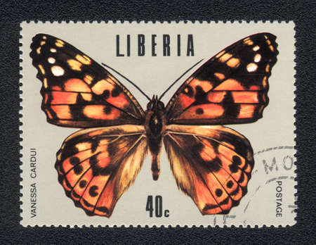 vanessa: LIBERIA : A Stamp printed in LIBERIA shows image of a butterfly Painted lady - Vanessa cardui Stock Photo