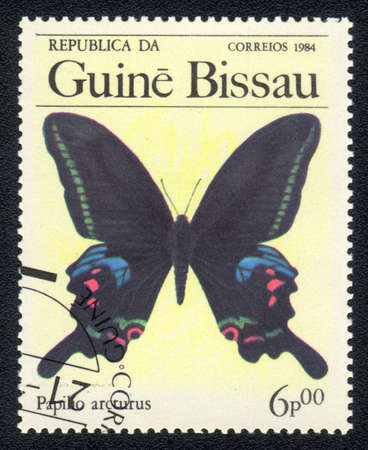 GUINEA-BISSAU - CIRCA 1984: A Stamp printed in GUINEA-BISSAU shows image of a  butterfly Blue Peacock - papilio arcturus, circa 1984  Stock Photo - 10088602