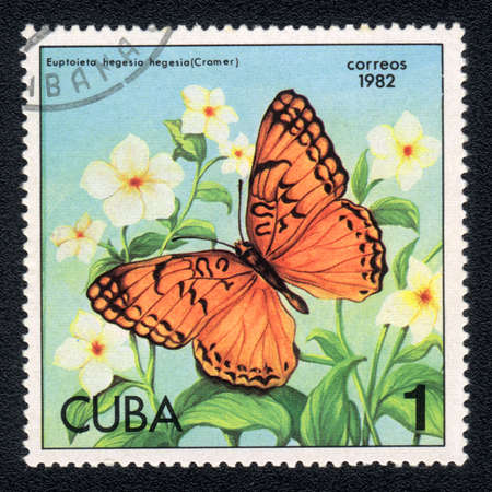 cuba butterfly: CUBA - CIRCA 1982: A Stamp printed in CUBA and shows image of a  butterfly Mexican Fritillary (euptoieta hegesia) on the plant background, circa 1982 Stock Photo