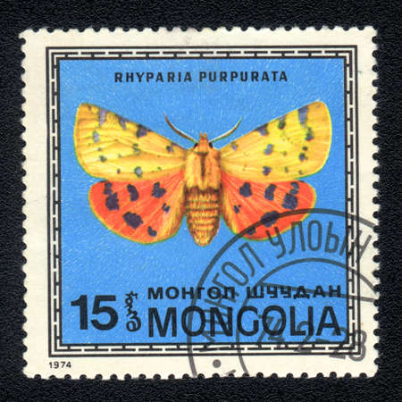 MONGOLIA -  CIRCA 1974: A Stamp printed in MONGOLIA shows image of a Rhyparia purpurata  butterfly, circa 1974 photo