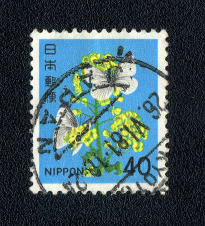 Japan - CIRCA 1981: A Stamp printed in  Japan shows image of a flower and butterfly, circa 1981  Stock Photo - 10181622