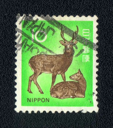 dappled: Japan - CIRCA 1975: A Stamp printed in Japan  shows image of a dappled deer, circa 1975  Stock Photo