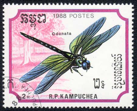 anisoptera: KAMPUCHEA - CIRCA 1988: A stamp printed in Kampuchea shows a dragonfly - odonata, circa 1988