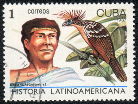 indian postal stamp: CUBA - CIRCA 1987: A Stamp printed in CUBA shows image of a  calarca (Colombia) and opisthocomus hoazin, from series Historia Latinoavericana, circa 1987 Stock Photo