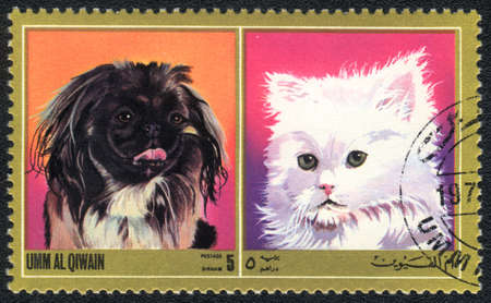 philatelic: Umm al Qiwain - CIRCA 1971: A stamp printed in Umm al Qiwain shows cat and dog from series: Different breeds of dogs and cats, circa 1971
