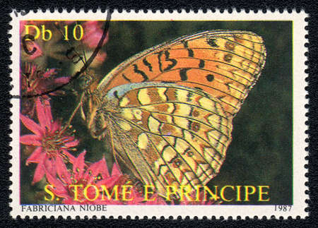 Sao Tome and Principe- CIRCA 1987: A Stamp printed in Sao Tome and Principe shows image of a (Fabriciana niobe) butterfly , circa 1987  photo