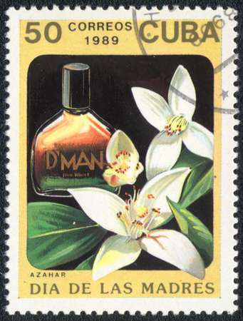 CUBA - CIRCA 1989: A stamp printed in CUBA shows a Bottle of azahar perfume, circa 1989  photo