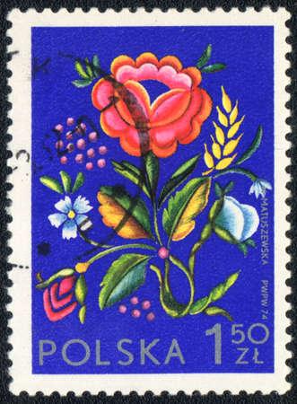 Poland - CIRCA 1974: A stamp printed in Poland  shows  a Polish floral design, series, circa 1974 photo
