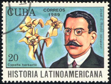 essayist: CUBA - CIRCA 1989: A stamp printed in CUBA  shows  a Cypella and essayist José Enrique Rodó, series Historia Latinoamericana, circa 1989 Editorial