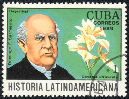 sarmiento: CUBA - CIRCA 1989: A stamp printed in CUBA  shows  a  Govenia utriculata and Domingo F.Sarmiento, series Historia Latinoamericana, circa 1989 Editorial