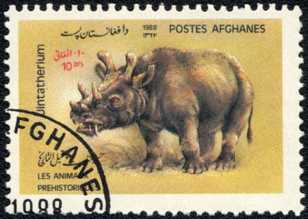 AFGHANISTAN - CIRCA 1988: A stamp printed in AFGHANISTAN shows Uintatherium, series, circa 1988 photo