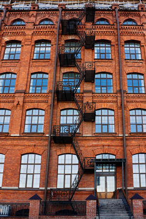 Old brick building with fire-escape Stock Photo