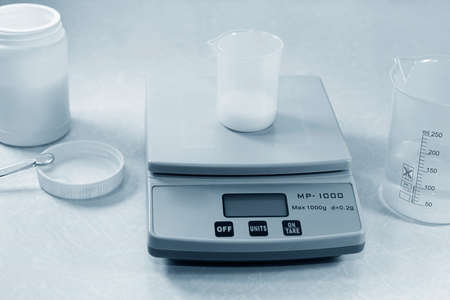 Weighing in chemistry laboratory Stock Photo