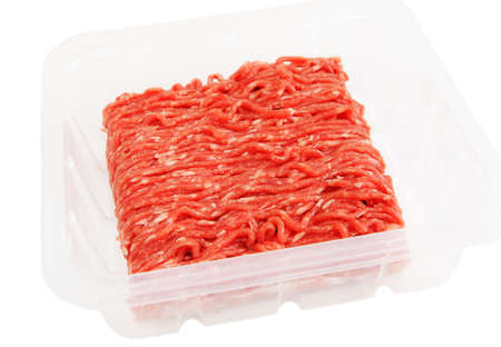 Plastic packaging with raw ground beef isolated on white bachground photo