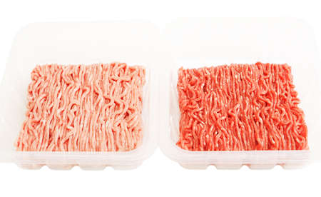 Plastic packaging with raw ground beef and pork isolated on white bachground Stock Photo - 13175150
