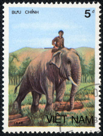 indian postal stamp: VIETNAM - CIRCA 1986: A stamp printed in VIETNAM shows worker  elephant, Asian elephant series, circa 1986