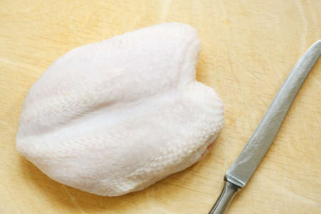 Fresh chicken breast on a wooden cutting board Stock Photo - 13331513
