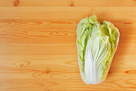 Chinese cabbage head out on a wooden surface. View from the top Stock Photo - 13496169