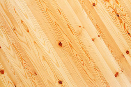 The smooth surface of the boards with knots as background Stock Photo
