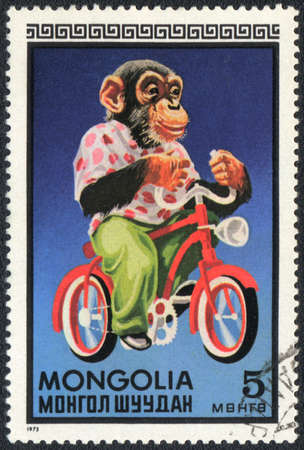 perforated stamp: MONGOLIA - CIRCA 1973: A stamp printed in MONGOLIA shows a Chimpanzees - cyclist, circus series, circa 1973 Stock Photo
