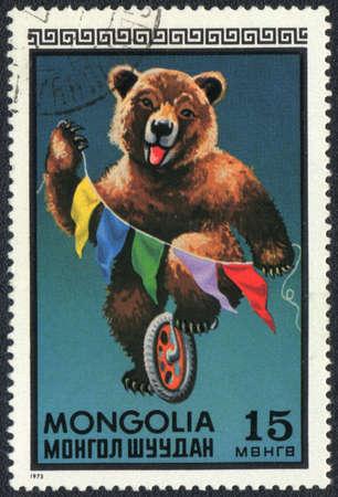 MONGOLIA - CIRCA 1973: A stamp printed in MONGOLIA shows a brown bear, circus series, circa 1973 photo