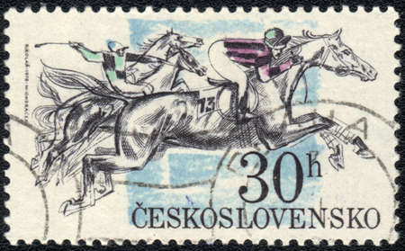 CZECHOSLOVAKIA - CIRCA 1984: A stamp printed in CZECHOSLOVAKIA  shows  a Horse racing, Equestrianism series photo