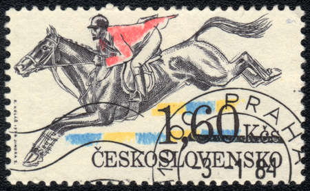 CZECHOSLOVAKIA - CIRCA 1984: A stamp printed in CZECHOSLOVAKIA  shows  a  Show jumping, Equestrianism series Stock Photo - 13656440