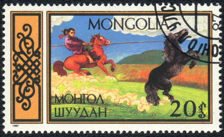 mongolia horse: MONGOLIA - CIRCA 1987: A stamp printed in MONGOLIA  shows  a  Catching a wild horse, National forms of equestrian sport series, circa 1987