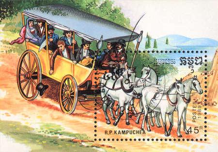 the coachman: R.P. KAMPUCHEA - CIRCA 1989: A stamp printed in R.P. KAMPUCHEA  shows  a stagecoach, draught horse and coach series, circa 1989