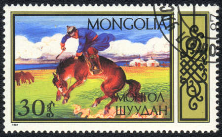 mongolia horse: MONGOLIA - CIRCA 1987: A stamp printed in MONGOLIA  shows  a Taming of the horse , National forms of equestrian sport series, circa 1987 Stock Photo