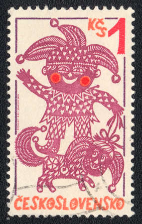 CZECHOSLOVAKIA - CIRCA 1980: A stamp printed in CZECHOSLOVAKIA  shows Punch and dog, from series, circa 1980 photo