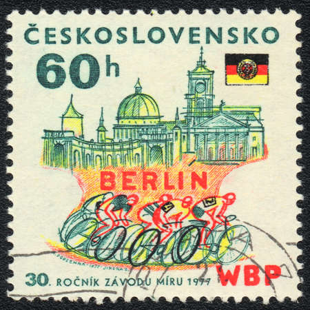 CZECHOSLOVAKIA - CIRCA 1977: A stamp printed in CZECHOSLOVAKIA  shows Bicycle racing in Berlin, from series, circa 1977 photo
