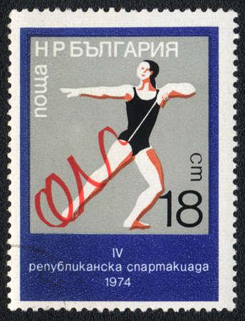 BULGARIA - CIRCA 1974: A stamp printed in BULGARIA   shows  Ribbon (rhythmic gymnastics), circa 1974  photo