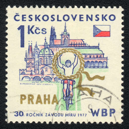 CZECHOSLOVAKIA - CIRCA 1977: A stamp printed in CZECHOSLOVAKIA  shows Bicycle racing in Prague, from series, circa 1977 photo
