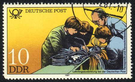 apprenticeship: DDR - CIRCA 1981: A stamp printed in DDR   shows  apprenticeship training , from series  Postal History of Germany, circa 1981