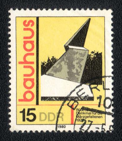 ddr: DDR- CIRCA 1980: A stamp printed in DDR  shows Bauhaus school, circa 1980 Stock Photo