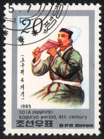 panpipe: DPR KOREA - CIRCA 1985: A stamp printed in DPR KOREA  shows A panpipe 4th centur, from series, circa 1985  Stock Photo