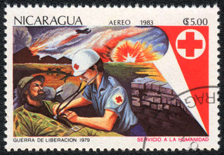 NICARAGUA - CIRCA 1983: A stamp printed in NICARAGUA  shows Rescue injured, from series Red Cross,circa 1983 Stock Photo - 13960532