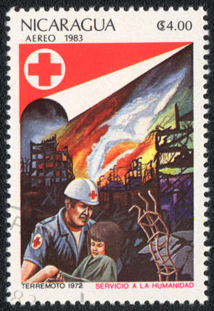 NICARAGUA - CIRCA 1983: A stamp printed in NICARAGUA  shows Salvation by fire, from series Red Cross, circa 1983 photo