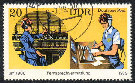 DDR - CIRCA 1979: A stamp printed in DDR   shows  telephony, from series Postal History of Germany, circa 1979 photo