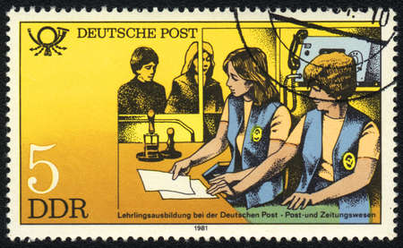 DDR - CIRCA 1981: A stamp printed in DDR   shows  Training personnel to work c mailings, from series Postal History of Germany, circa 1981 photo