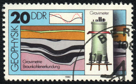 ddr: DDR - CIRCA 1980: A stamp printed in DDR   shows Gravimetry, from series Geophysics, circa 1980