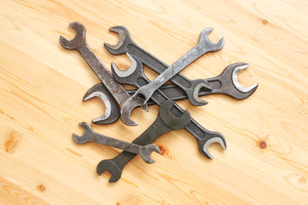 Piles of straight spanners on wooden Stock Photo - 13960447