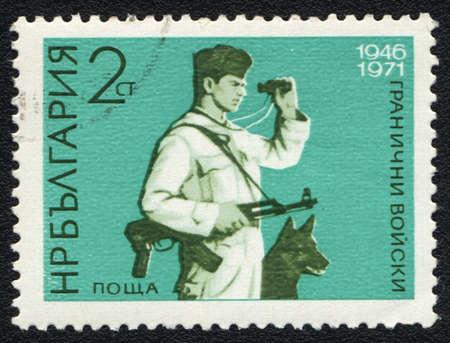 BULGARIA - CIRCA 1971: A stamp printed in BULGARIA   shows Bulgarian border guards, circa 1971 Stock Photo