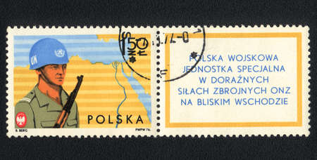 POLAND - CIRCA 1976: A stamp printed in Poland  shows Polish military special unit in ad hoc UN Armed Forces in the Middle East ,  circa 1977 photo