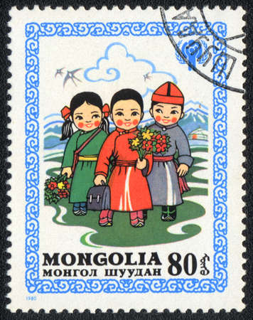 perforated stamp: MONGOLIA - CIRCA 1980  A stamp printed in MONGOLIA   shows Children go to school, from series Happy childhood, circa 1980  Stock Photo