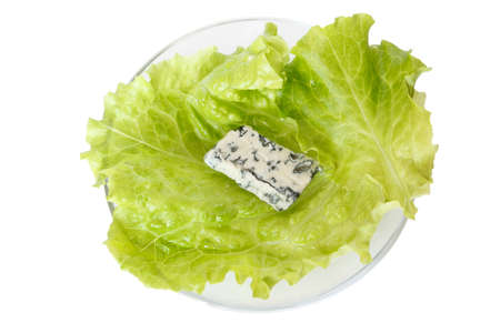 morsel: A morsel of blue cheese on leaf of lettuce isolated on white background Stock Photo