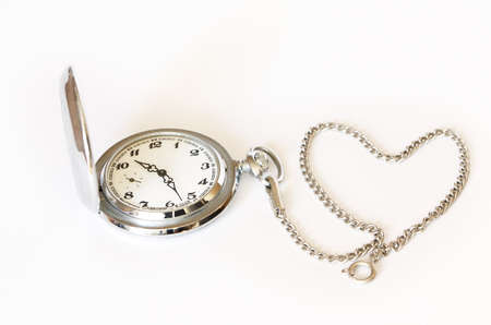 Pocket watch with chain in the form of a  heard  on white background photo