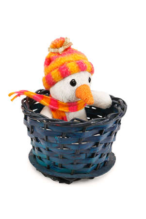 Toy snowman sitting in a wicker basket isolated on white background Stock Photo - 16081689