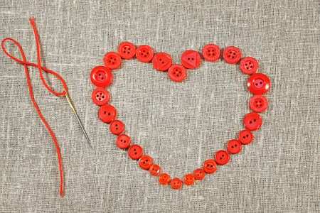 darning needle: Heart in shape of red buttons and darning needle City of St  Petersburg was called Leningrad in USSR Stock Photo